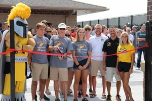 Athletes and coaches cut the ribbon at the Waupun Athletic Complex grand opening.