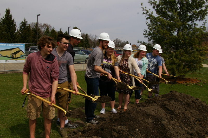 Students holding golden shovels at ground breaking ceremony for the Warrior Innovation Center