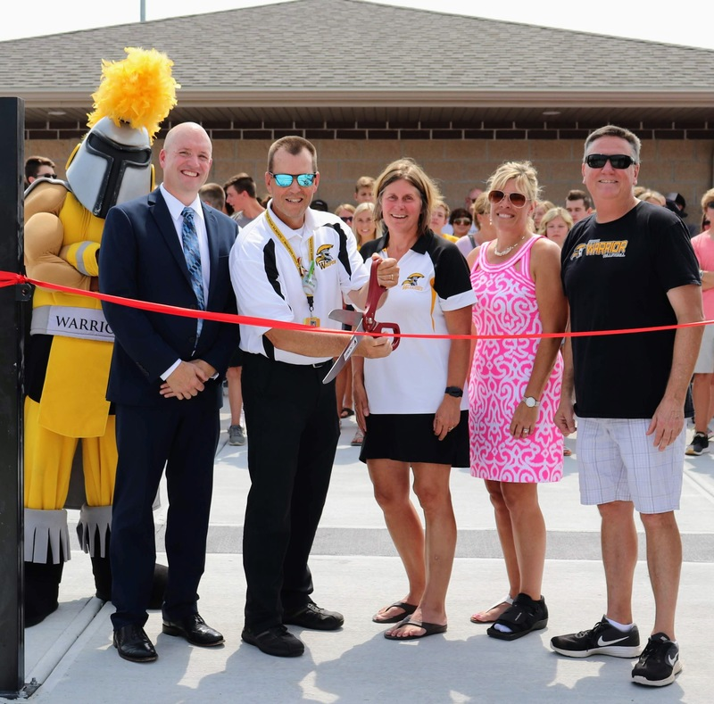 WASD adminstration and former District Adminstrator pose at Waupun Warrior Athletic Complex ribbon cutting ceremony